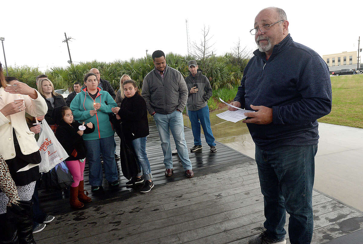 Rev. Dan Brack of Turning Point Church in Vidor, offers words of prayer during a candlelight vigil in honor of Savanna Roque who was killed last week in her home in Orange. Her father, Yohavnis Roque, has been charged with capital murder in his daughter's death. Photo taken Monday, February 25, 2019 Kim Brent/The Enterprise