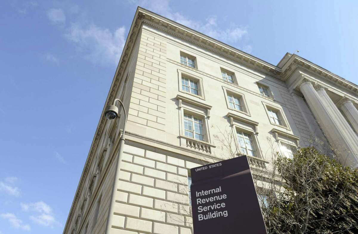 FILE - This March 22, 2013, file photo, shows exterior of the Internal Revenue Service building in Washington. Fake IRS agents have targeted more than 366,000 people with harassing phone calls demanding payments and threatening jail as part of a huge nationwide tax scam that has cost taxpayers $15.5 million. More than 3,000 people have fallen for the ruse since 2013, Timothy Camus, a Treasury deputy inspector general for tax administration, said Thursday, March 12, 2015. (AP Photo/Susan Walsh, File)