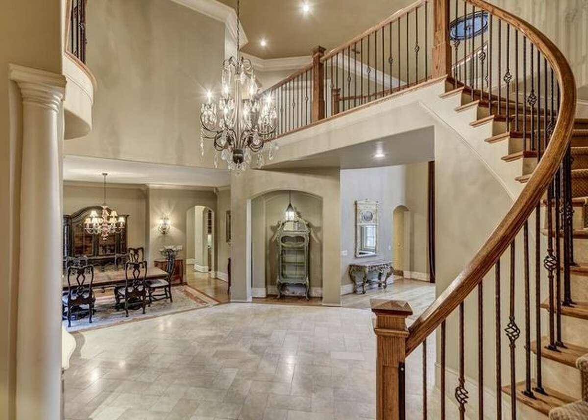 Two-story foyer with curved staircase.