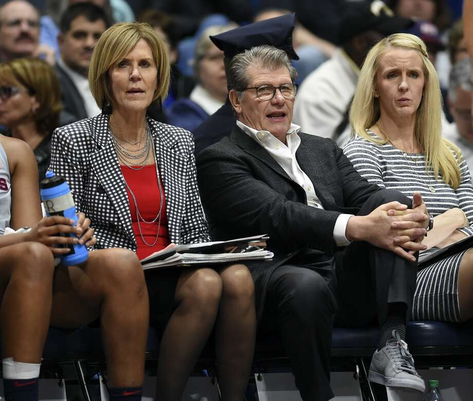 Connecticut head coach Geno Auriemma sits on the bench with his assistant coaches during the second half of an NCAA college basketball game against East Carolina Wednesday, Feb. 6, 2019 in Hartford, Conn. (AP Photo/Stephen Dunn) Photo: Stephen Dunn, Associated Press