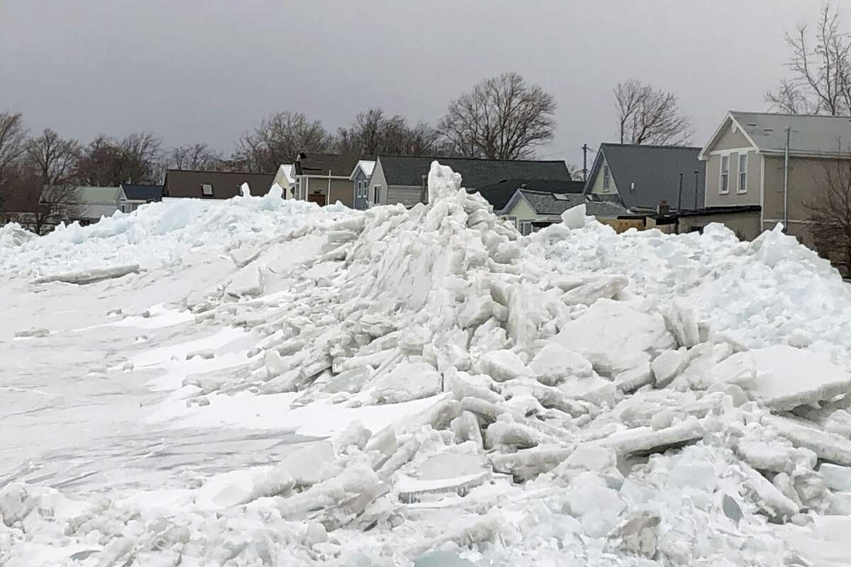 Mounds of ice collect along the Lake Erie shore at Hoover Beach, in Hamburg, N.Y., Monday, Feb. 25, 2019. High winds howled through much of the nation's eastern half for a second day Monday, cutting power to hundreds of thousands of homes and businesses, closing schools, and pushing dramatic mountains of ice onto the shores of Lake Erie.(AP Photo/Carolyn Thompson)