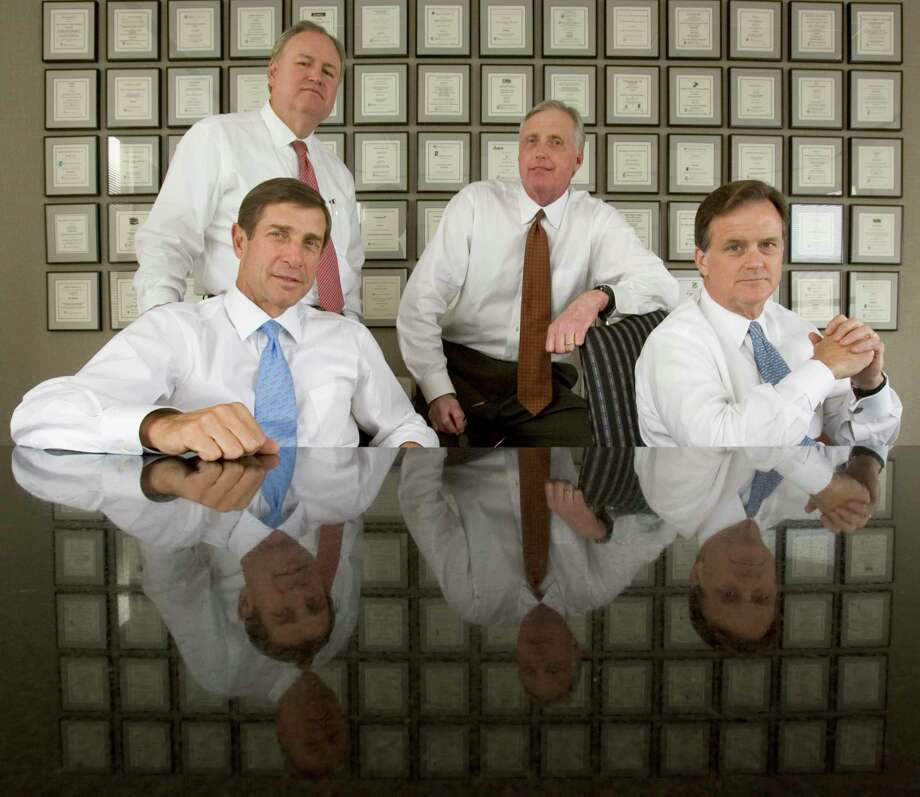 The Texas School Land Board has committed $1.8 billion in investments to Houston-based EnCap Investments and an affiliate.  Executives of the company, which is one of the largest energy private equity firms in the country, are shown in a 2006 photo. Photo: Brett Coomer / Houston Chronicle