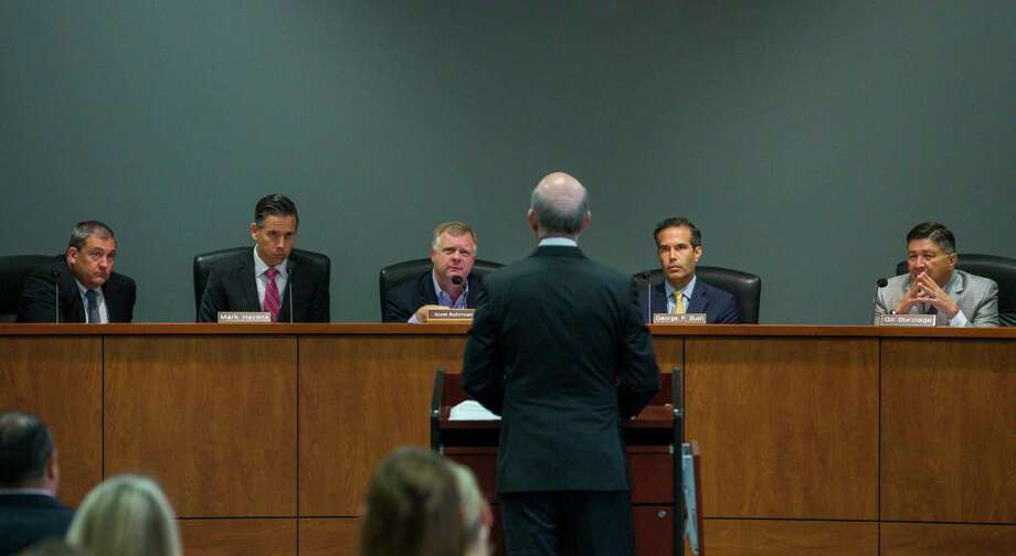 Texas' School Land Board controls how $10 billion of the state's $44 billion Permanent School Fund is invested. From right to left are board member Gilbert Burciaga, chairman George P. Bush, board member Scott Rohrman, and staffers Mark Havens, deputy land commissioner and Jeff Gordon, general counsel. Photo: Mark Mulligan, Staff Photographer / © 2018 Mark Mulligan / Houston Chronicle