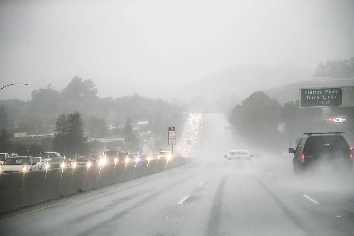 Southbound Highway 101 is heavy during the storm on Monday, Feb. 25, 2019 in Larkspur, CA.