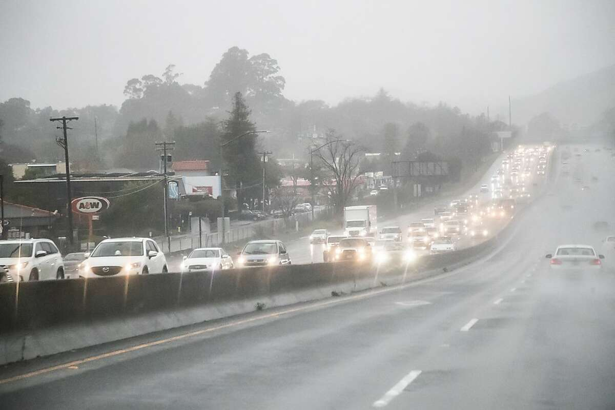 Southbound Highway 101 is heavy during the storm on Monday, Feb. 25, 2019, in San Rafael.