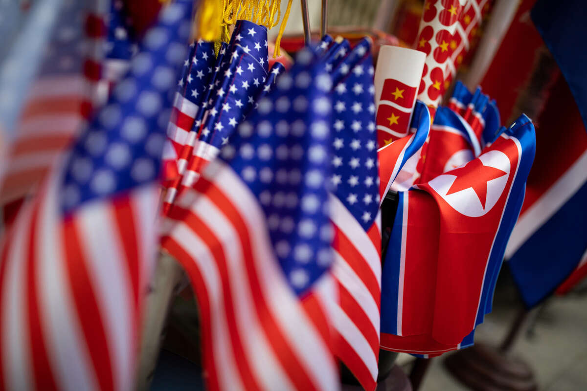 American, North Korean and Vietnamese national flags are displayed for sale at a store in Hanoi.