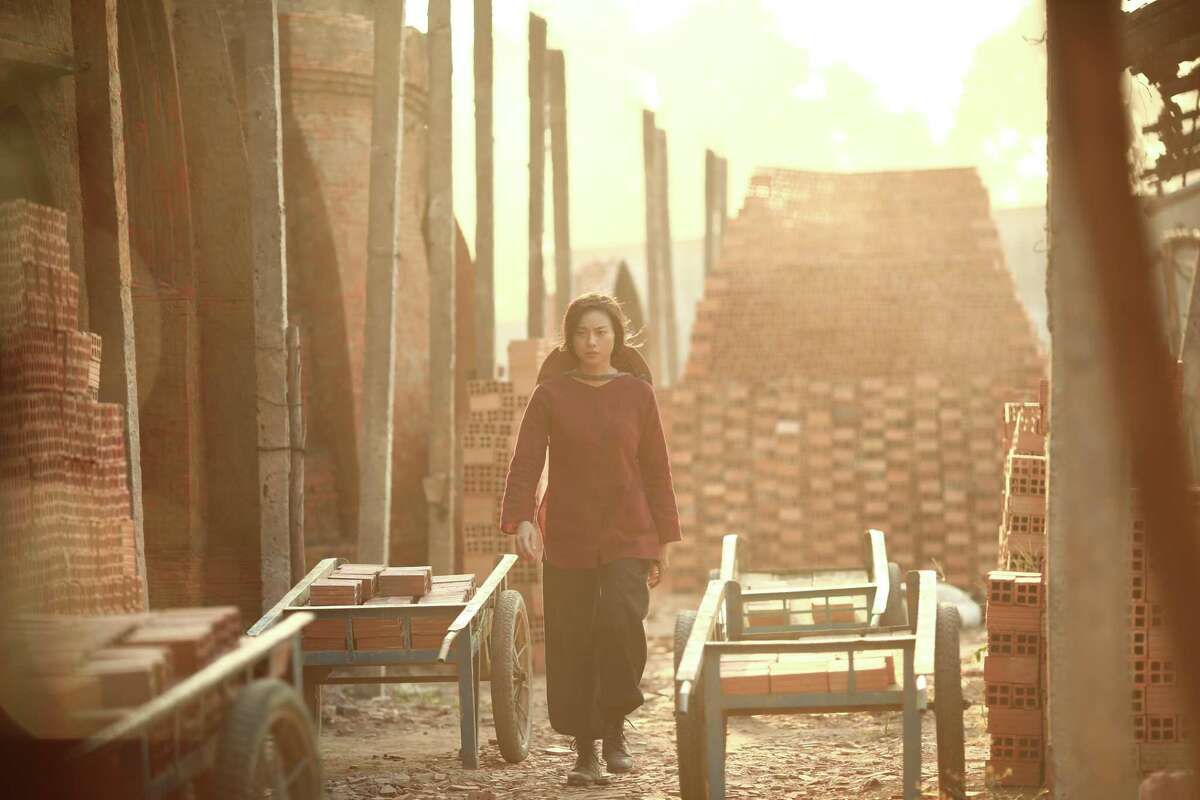 """Hai Phuong (Veronica Ngo) walks through a brick factory in director Le Van Kiet's """"Furie."""" The film features scenes in Can Tho and Ho Chi Minh City, the latter subtitled as Sai Gon."""