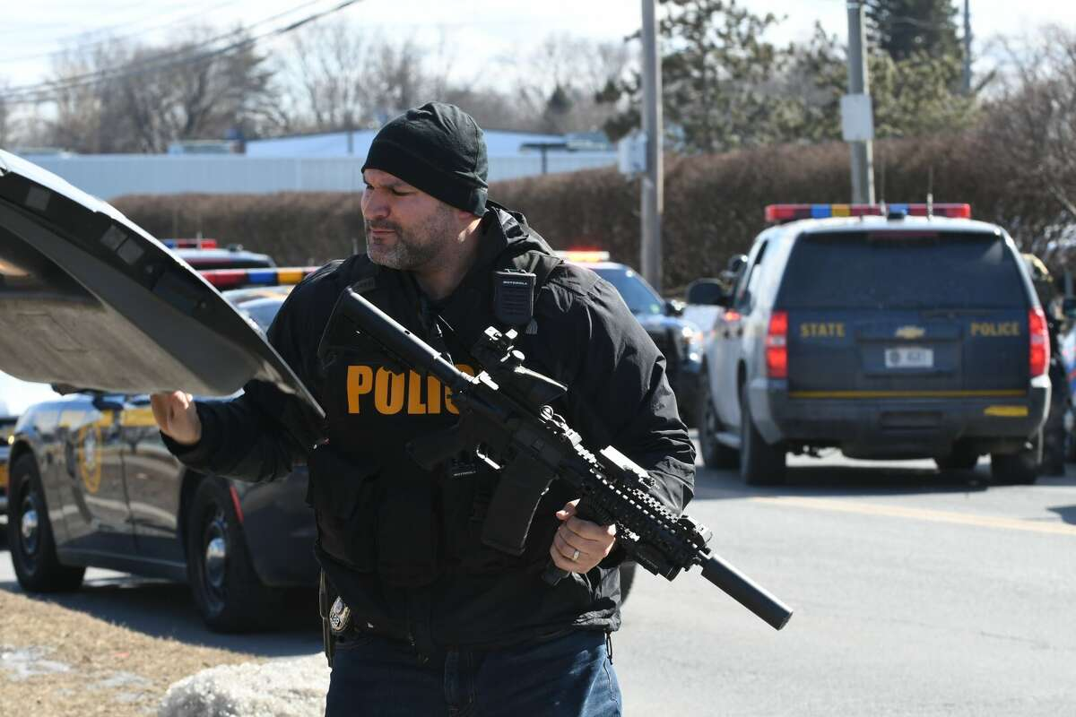 Police descended on an Albany motel as they investigate the armed robbery of a M&T Bank in North Greenbush.