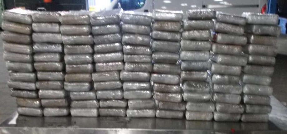 CBP officers discovered 99 bundles containing 264 pounds of alleged cocaine hidden within a a 2003 Freightliner tractor hauling an empty trailer on Thursday. Photo: CBP