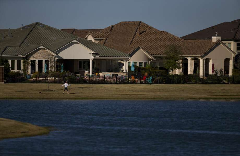 Houses belonging to former Sugar Land mayor James Thompson and executive Doug Goff in Imperial Sugar Land. Photo: Mark Mulligan/Staff Photographer