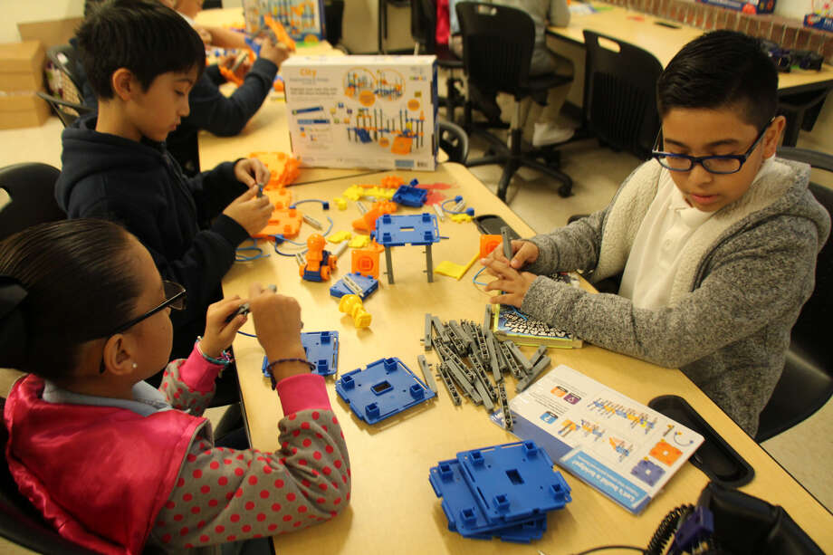 Tyrell Elementary students work with the new science equipment purchased with grant funds from BASF TOTAL Petrochemicals LLC during National Engineering Week. Photo: BASF TOTAL