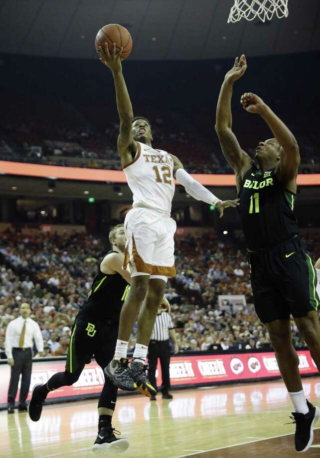 Texas guard Kerwin Roach II (12) shoots past Baylor guard Mark Vital (11) during the second half on an NCAA college basketball game, Wednesday, Feb. 6, 2019, in Austin, Texas. (AP Photo/Eric Gay) Photo: Eric Gay, STF / Associated Press / Copyright 2019 The Associated Press. All rights reserved.