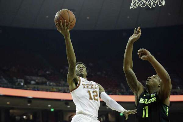 Texas guard Kerwin Roach II (12) shoots past Baylor guard Mark Vital (11) during the second half on an NCAA college basketball game, Wednesday, Feb. 6, 2019, in Austin, Texas. (AP Photo/Eric Gay)