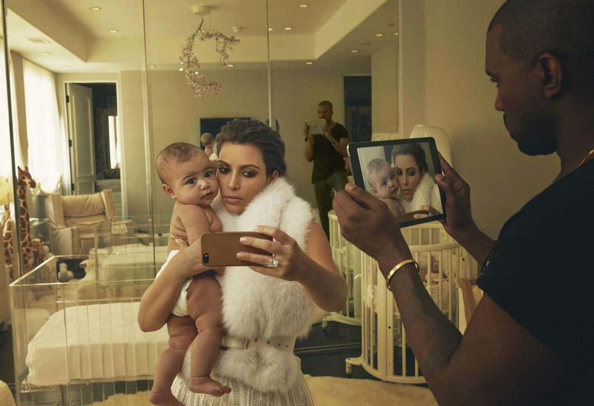 Annie Leibovitz's 2014 portrait of Kim Kardashian, North West, and Kanye West is included in the coffee table book