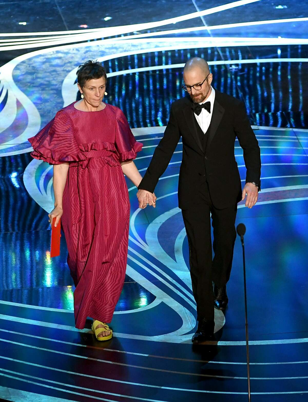 HOLLYWOOD, CALIFORNIA - FEBRUARY 24: (L-R) Frances McDormand and Sam Rockwell speak onstage during the 91st Annual Academy Awards at Dolby Theatre on February 24, 2019 in Hollywood, California. (Photo by Kevin Winter/Getty Images)