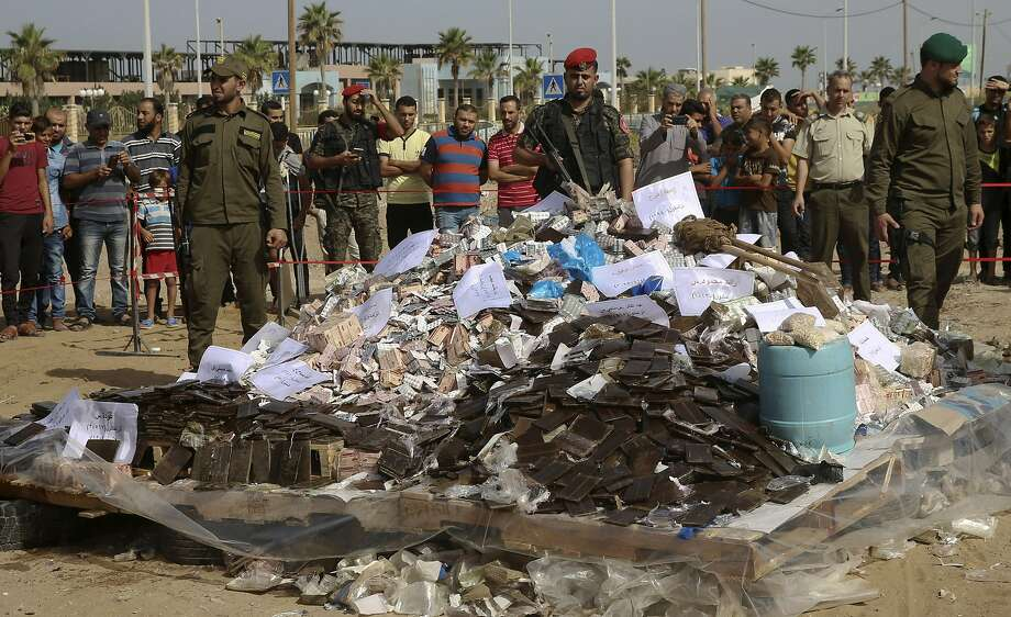 Hamas forces prepare to burn hashish and cheap opioid-based Tramadol pills in 2018 in Gaza City. Photo: Adel Hana / Associated Press 2018