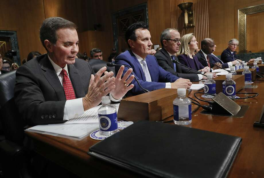 Richard A. Gonzalez, far left, Chairman and Chief Executive Officer AbbVie Inc., testifying before the Senate Finance Committee hearing on drug prices, Tuesday, Feb. 26, 2019 on Capitol Hill in Washington. Sitting with Gonzalez are l-r., Pascal Soriot, Executive Director and Chief Executive Officer AstraZeneca, Giovanni Caforio, M.D. Chairman of the Board and Chief Executive Officer Bristol-Myers Squibb Co., Jennifer Taubert, Executive Vice President, Worldwide Chairman, Janssen Pharmaceuticals Johnson & Johnson, Kenneth C. Frazier, Chairman and Chief Executive Officer Merck & Co., Inc., Albert Bourla, DVM, Ph.D. Chief Executive Office Pfizer, Olivier Brandicourt, M.D. Chief Executive Officer Sanofi. (AP Photo/Pablo Martinez Monsivais) Photo: Pablo Martinez Monsivais, Associated Press