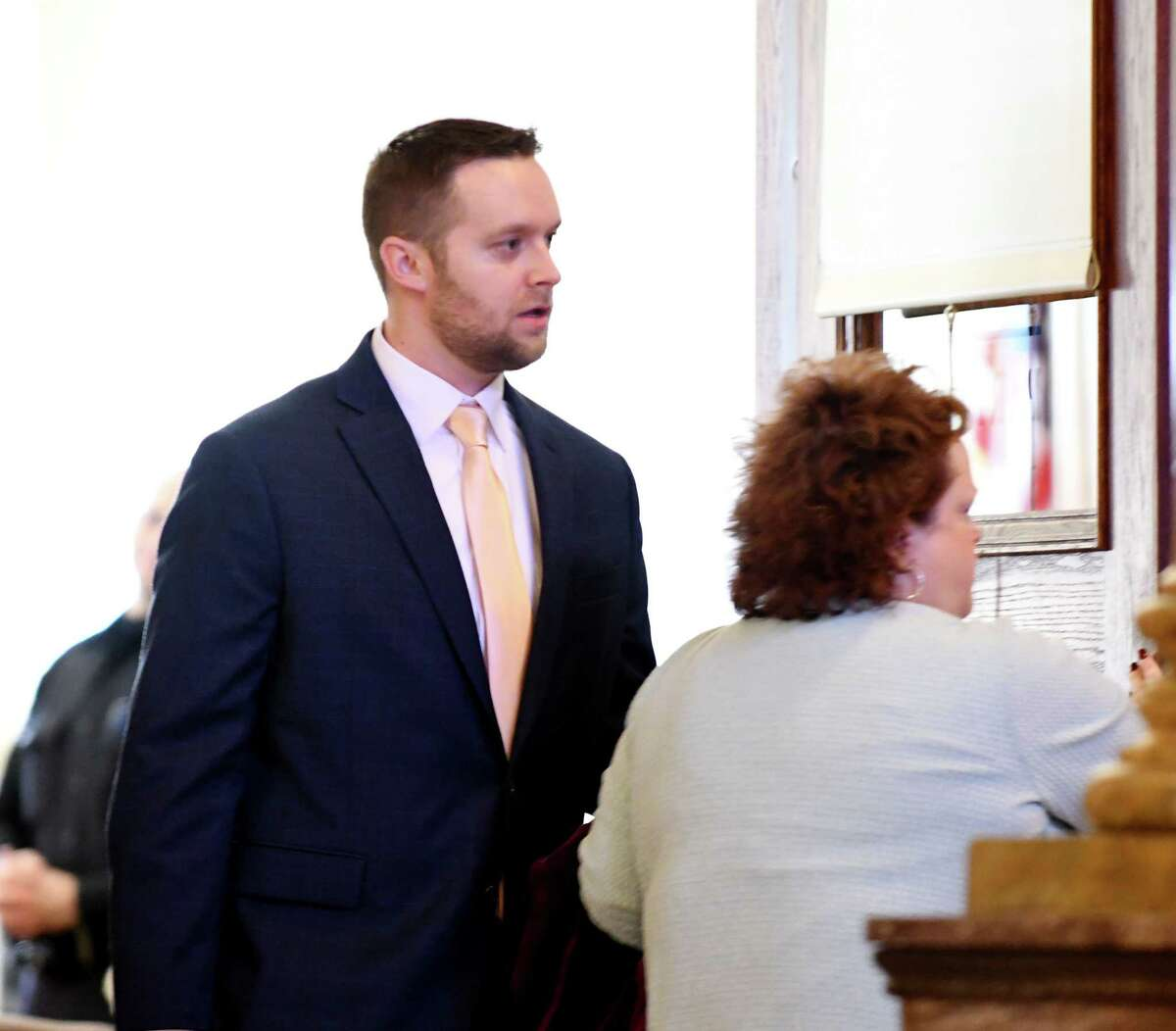 Troy code enforcement officer James E. Lance III leaves Judge Jennifer Sober's courtroom after pleading not guilty to an indictment in connection with the 2015 sale of wooded lot in Lansingburgh to a former city engineer on Tuesday, Feb. 26, 2019, at the Rensselaer County Courthouse in Troy, N.Y. (Will Waldron/Times Union)