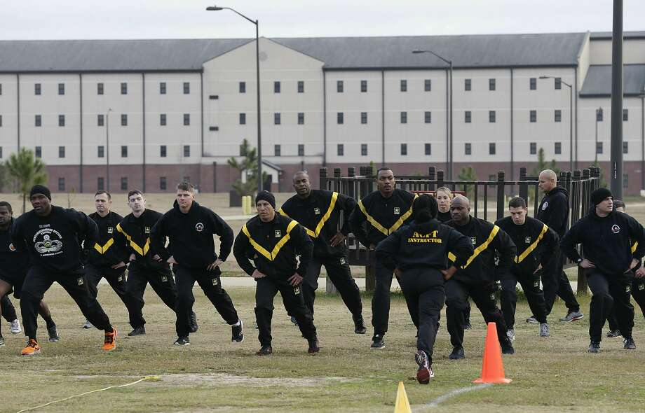 Army troops training to serve as instructors participate in a new fitness test at Fort Bragg, N.C. Photo: Gerry Broome / Associated Press
