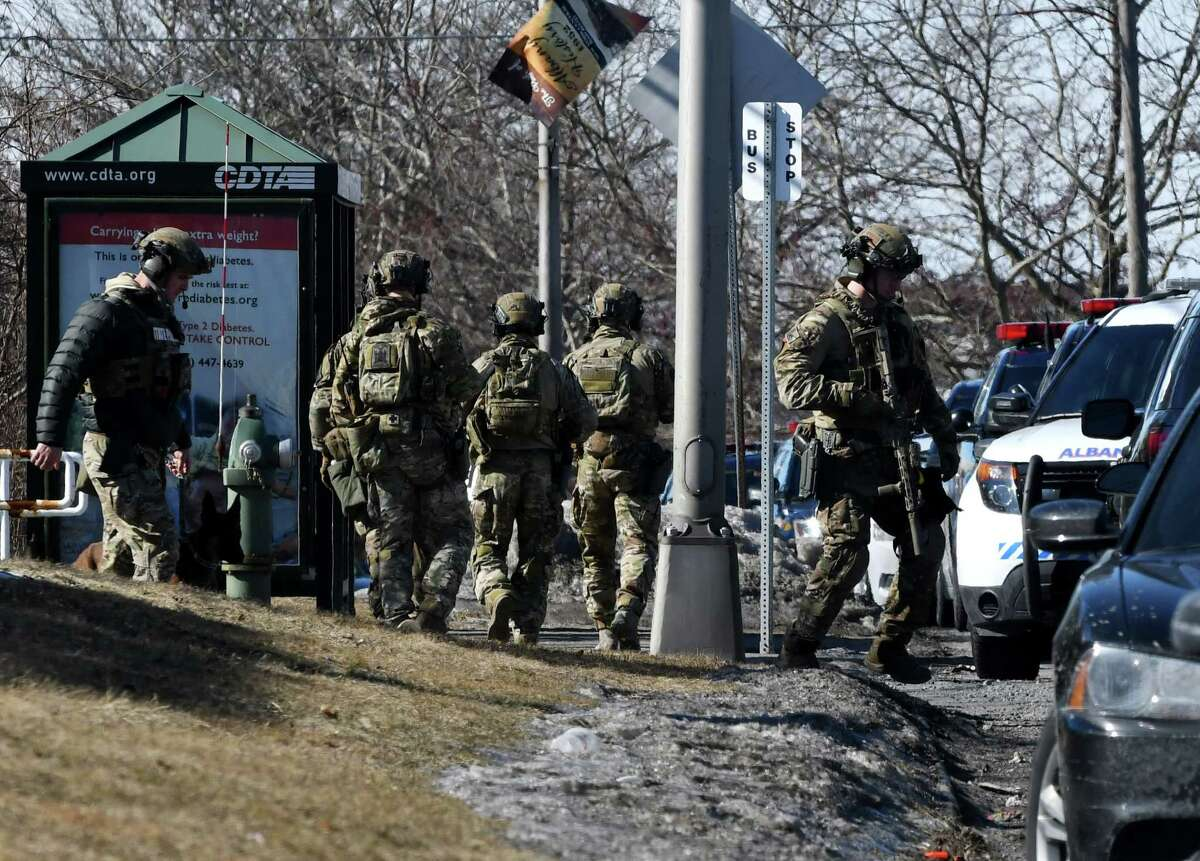 State Police tactical team members leave the Motel 6 on Watervliet Ave. Ext. where they searched for suspects in a North Greenbush bank robbery on Tuesday, Feb. 26, 2019, in Albany, N.Y. (Will Waldron/Times Union)