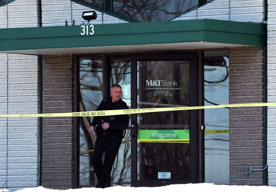 Police leave the M&T Bank branch on Route 4 following a robbery on Tuesday, Feb. 26, 2019, in North Greenbush, N.Y. (Will Waldron/Times Union) Photo: Will Waldron, Albany Times Union