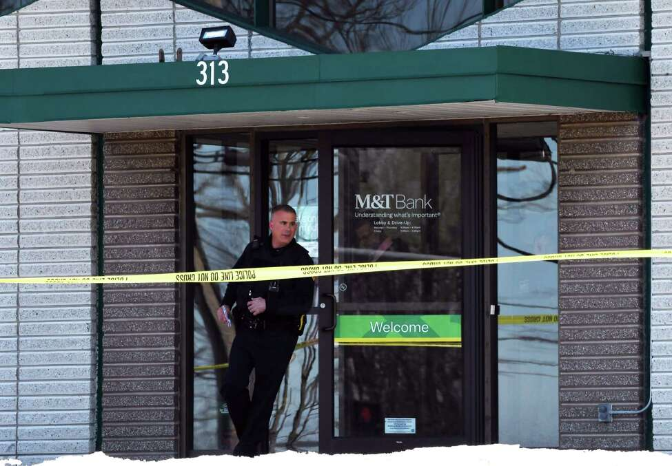 Police leave the M&T Bank branch on Route 4 following a robbery on Tuesday, Feb. 26, 2019, in North Greenbush, N.Y. (Will Waldron/Times Union)