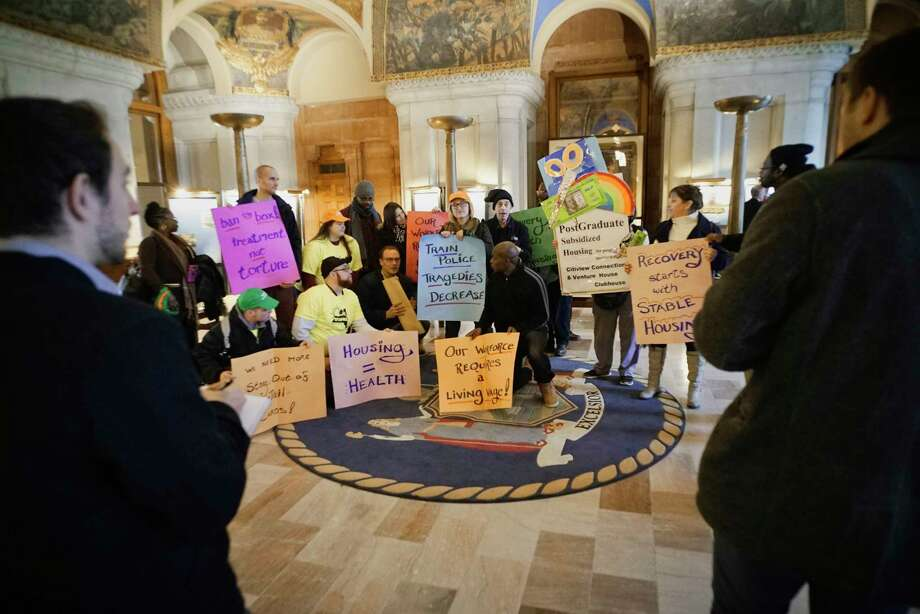 Mental health advocates and community providers from across the State take part in a rally inside the Capitol on Tuesday, Feb. 26, 2019, in Albany, N.Y. Those taking part in the rally were calling on legislators to address housing concerns, and criminal justice reforms.  (Paul Buckowski/Times Union) Photo: Paul Buckowski, Albany Times Union / (Paul Buckowski/Times Union)