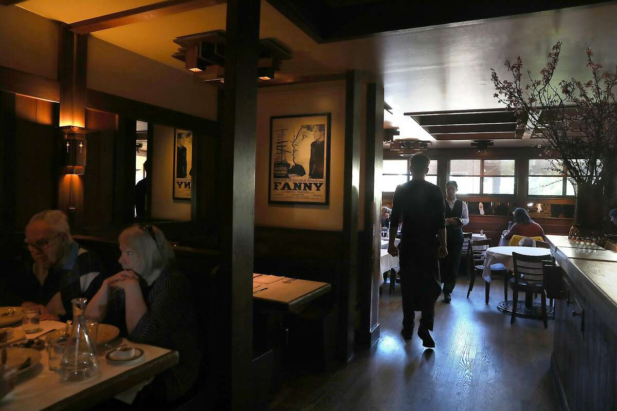 View of part of the upstairs restaurant during lunch at Chez Panisse cafe seen on Wednesday, Feb. 20, 2019, in Berkeley, Calif.