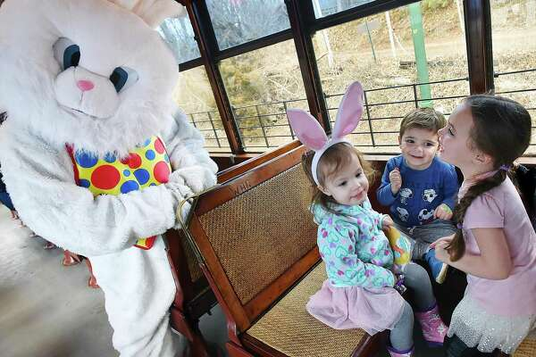 Penelope Monk, 4 and her 2-year-old sister Giulitta and their cousin Harper, 1, play with the Easter bunny at the Shore Line Trolley Museum in East Haven in March 2018.
