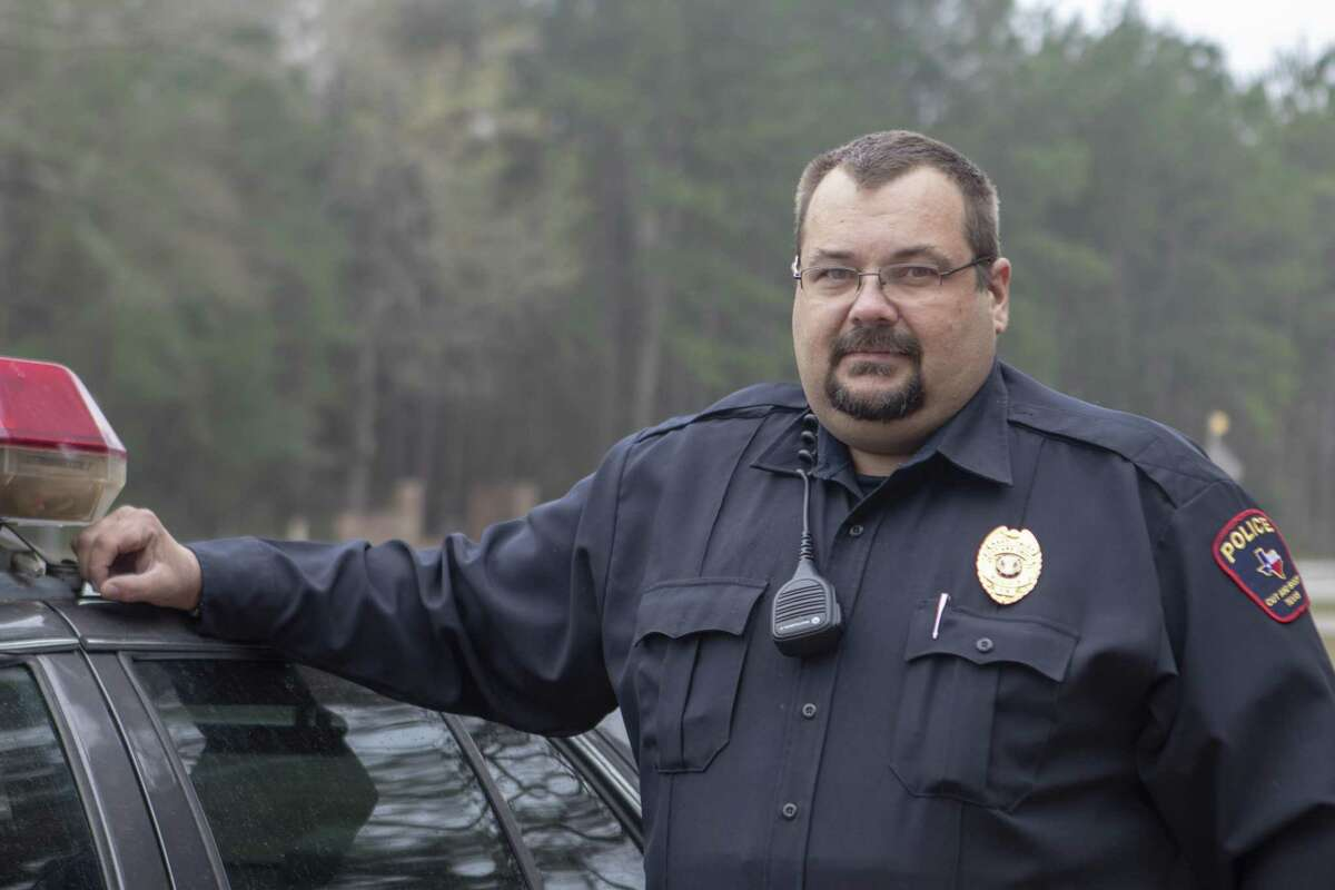 Henry Menz, Cut and Shoot assistant police chief, stands beside a patrol unit Tuesday, Feb. 26, 2019 at the Cut and Shoot Police Department. Menz was off duty when he stopped an attempted robbery Monday, Feb. 18, 2019.