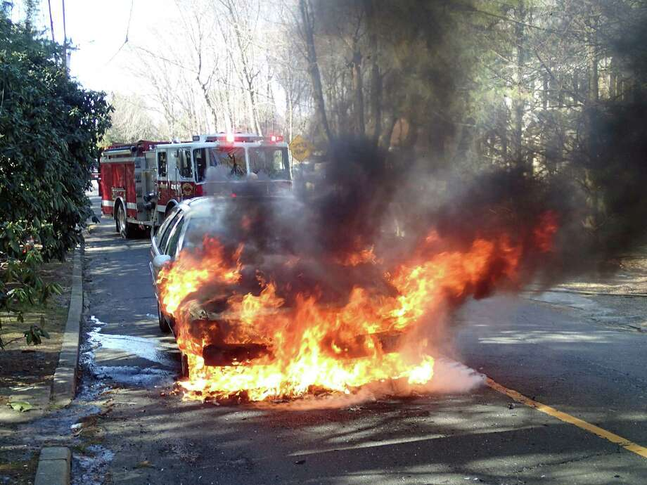 Around 11:25 a.m., the Westport Fire Department responded to Old Road in Westport, Conn., on Feb. 26, 2019, for a report of a car fire on Old Road. The first fire engine on scene reported a heavily involved car fire. Additional units arrived on scene soon after and helped extinguish the fire. Photo: Contributed Photo / Westport Fire Department / Contributed Photo / Connecticut Post Contributed