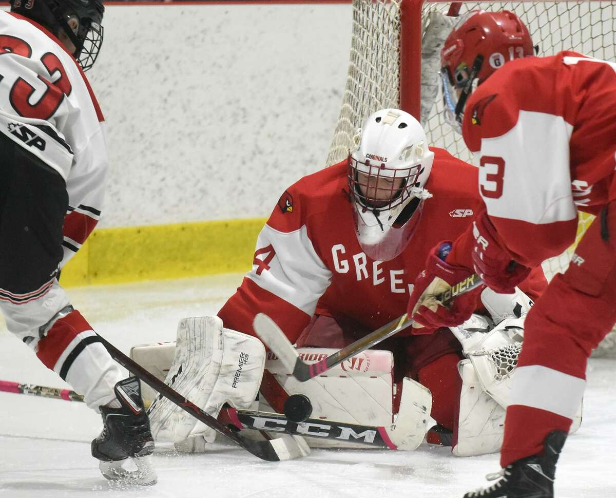 Greenwich goalie Charlie Zolin makes a save on a shot by New Canaan's Boden Gammill (23) during the FCIAC boys hockey playdowns at the Darien Ice House on Saturday, Feb. 23