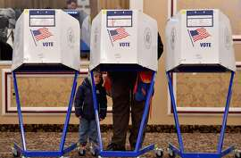"""(FILES) In this file photo taken on November 6, 2018 a voter casts his ballot in the midterm election at the East Midwood Jewish Center polling station in the Brooklyn borough of New York City. - Foreign meddling and hacking attempts had """"no material impact"""" on the US midterm congressional elections last year, according to a high-level review by the Justice and Homeland Security Departments on February 5, 2019. A summary of the classified report did not confirm various reports from state and local security officials during the campaign that foreign actors tried to break into voting systems and databases in multiple states. (Photo by Angela Weiss / AFP)ANGELA WEISS/AFP/Getty Images"""