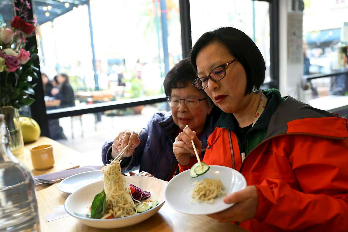 Carolyn Gee (left) lunches with her daughter, Sabrina Gee-Shin, at Cambodian restaurant Nyum Bai, located at 3340 E. 12th St. in Oakland, Calif. on Friday, February 15, 2019.