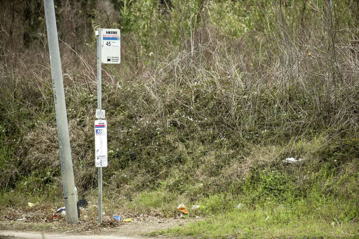 A bus stop in the 2300 block of Tidwell is surrounded by garbage on Feb. 22. Metropolitan Transit Authority is committing to millions of dollars in improvements aimed at easing travel and waits at bus stops.