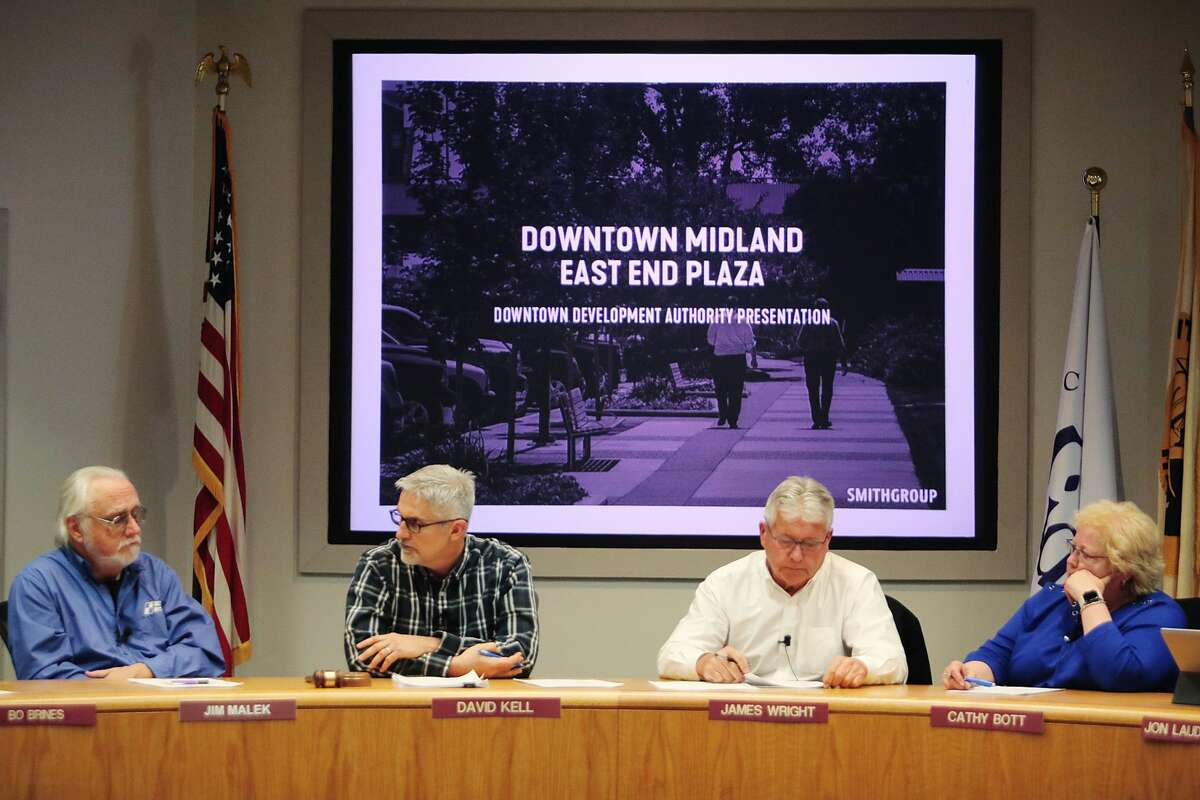 From left, Jim Malek, David Kell, James Wright and Cathy Bott of the Downtown Development Authority prepare to hear a presentation about the East End Plaza project by SmithGroup and the Michigan Baseball Foundation on Tuesday, Feb. 26, 2019 at City Hall. (Katy Kildee/kkildee@mdn.net)