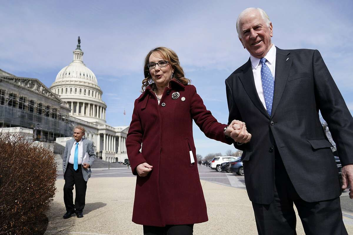 WASHINGTON, DC - FEBRUARY 26: Former Rep. Gabby Giffords (D-AZ) walks with Rep. Mike Thompson (D-CA) as she arrives to join Democratic lawmakers in support gun background checks legislation bill H.R. 8 on Capitol Hill on February 26, 2019 in Washington, D