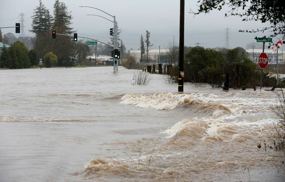 The intersection of Highways 121 and 12 are closed to traffic after the Sonoma Creek surged over its banks and flooded the roadway during the heavy rainstorm in Sonoma, Calif. on Tuesday, Feb. 26, 2019.