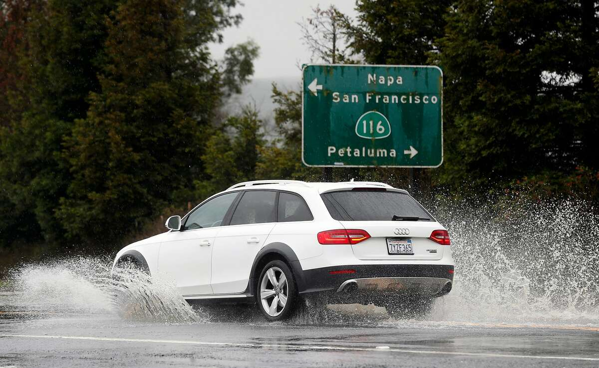 A motorist drives through deep standing water on Arnold Drive near Stage Gulch Road during the heavy rainstorm in Sonoma, Calif. on Tuesday, Feb. 26, 2019.