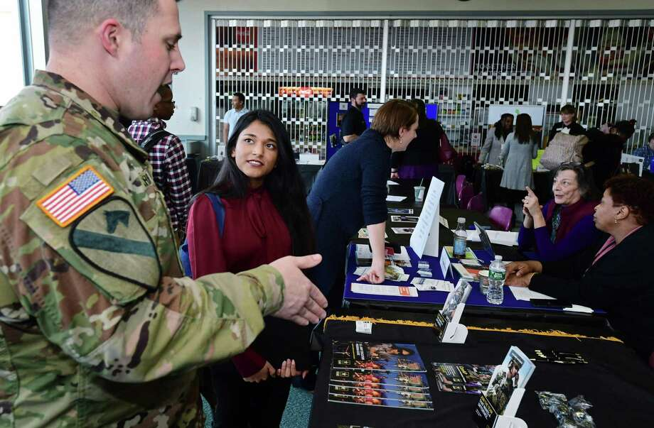 Norwalk Community College student Leena Adeel chats with US Army Recruiter Dillon Harrison during NCC's Career Expo on Tuesday in the West Campus Cafeteria and Culinary Arts Dining Room at Norwalk Community College in Norwalk. Photo: Erik Trautmann / Hearst Connecticut Media / Norwalk Hour