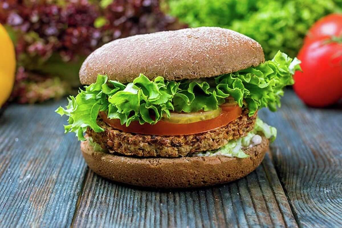 If you can find a veggie burger with a bean patty, you can easily top it with tomato, pickles, lettuce, onions, mustard, or ketchup.