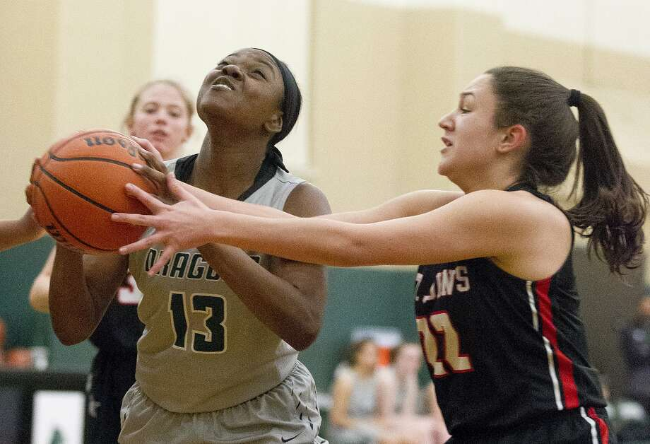 John Cooper guard Ajailah Ogiemwonyi (13) is one of the top returning players for the Dragons this season. Photo: Jason Fochtman, Staff Photographer