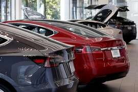 A Model 3 and Model S are displayed at the Tesla store in San Francisco, Calif. on Thursday, June 28, 2018.