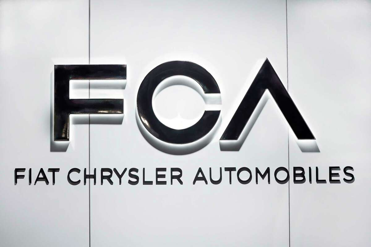 FILE - In this Monday, Jan. 14, 2019 file photo, Fiat Chrysler Automobiles FCA logo is shown at the North American International Auto Show in Detroit. Fiat Chrysler on Tuesday, Feb. 26, 2019 announced a $4.5 billion investment plan it said would increase its workforce in Detroit and the surrounding suburbs by about 6,500 jobs to build all-new or next-generation SUVs, (AP Photo/Paul Sancya, file)