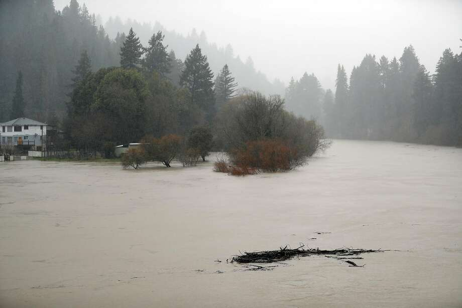 Debris flows down the Russian River a sit rises towards flood stage in Monte Rio, Calif., on Tuesday, February 26, 2019. Photo: Scott Strazzante