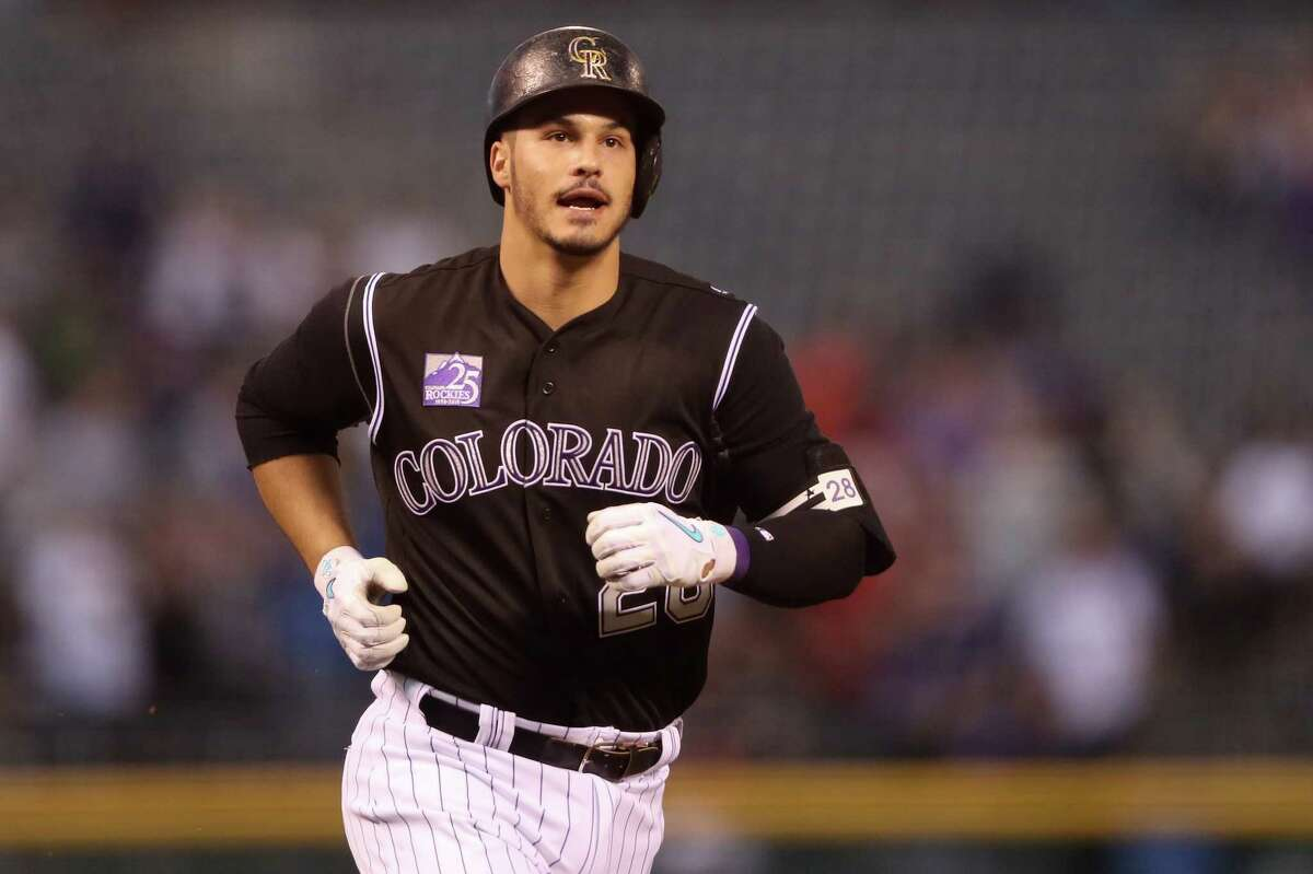 DENVER, CO - APRIL 23: Nolan Arenado #28 of the Colorado Rockies circles the bases on his two-run home run in the first inning against the San Diego Padres at Coors Field on April 23, 2018 in Denver, Colorado. (Photo by Matthew Stockman/Getty Images)