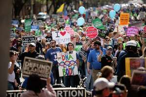 Attendees march during the Texas Rally for Life at the Texas State Capitol on January 26, 2019 in Austin, Texas.