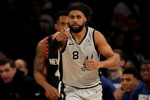 NEW YORK, NEW YORK - FEBRUARY 24:  Patty Mills #8 of the San Antonio Spurs celebrates his three point shot in the first half against the New York Knicks at Madison Square Garden on February 24, 2019 in New York City. NOTE TO USER: User expressly acknowledges and agrees that, by downloading and or using this photograph, User is consenting to the terms and conditions of the Getty Images License Agreement. (Photo by Elsa/Getty Images)