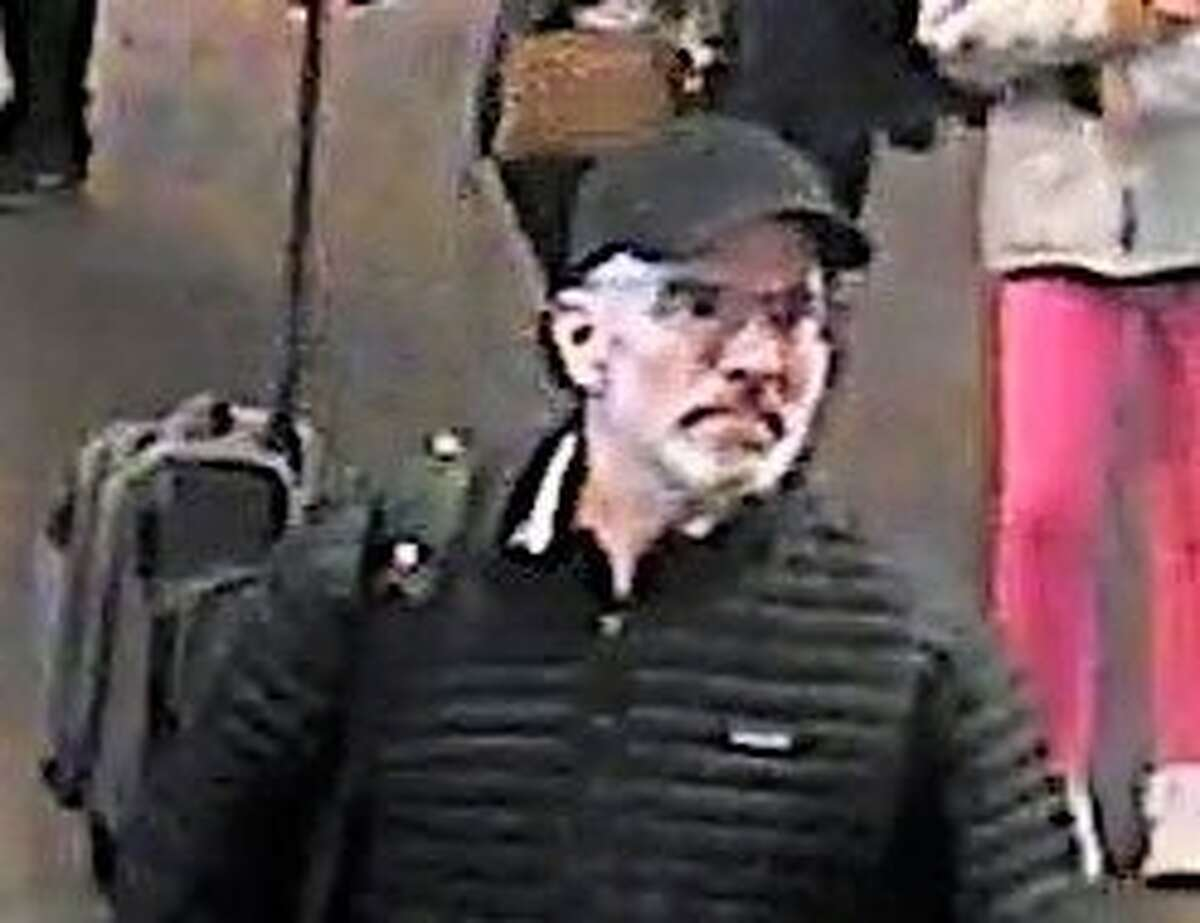 Police released a photo of a man suspected of stealing a bag containing a gun from a baggage carousel at SFO.