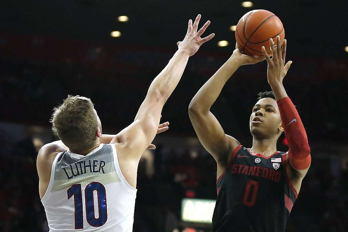 Stanford forward KZ Okpala (0) shoots over Arizona forward Ryan Luther in the first half during an NCAA college basketball game, Sunday, Feb. 24, 2019, in Tucson, Ariz. (AP Photo/Rick Scuteri)